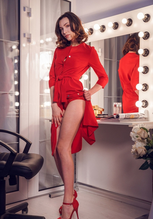 Beautiful actress remains without red dress and red lingerie in the dressing room