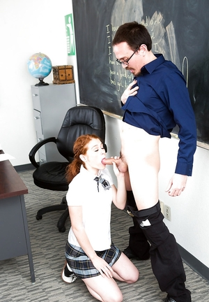 Modest youthful teacher receives awesome blowjob by red-haired schoolgirl on knees