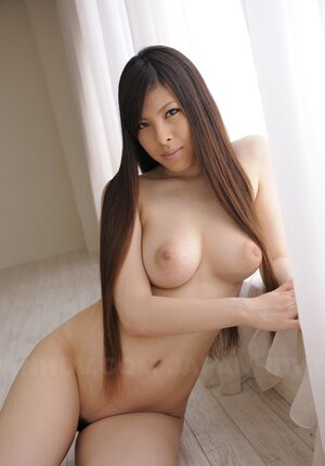 Undressed Japanese hottie gladly demonstrates impressive natural melons on cam