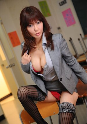 Oriental businesswoman wears as well hot stockings and plus red underwear under office outfit
