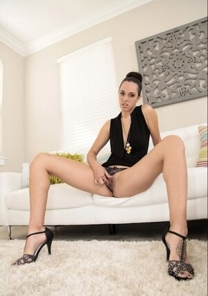 Beauty doesn't take off dress and moreover panties while touching honey pot on sofa