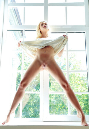 Sweet blonde with blue eyes welcomes sunny day by naked pictures