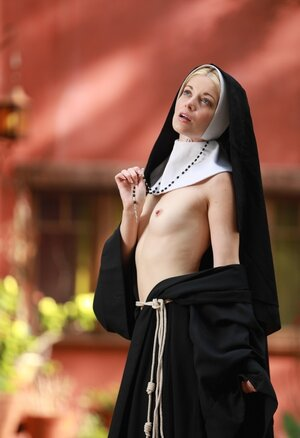 Skinny blonde nun provocatively shows small tits and cunny hidden under outfit