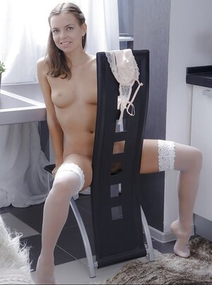 Tender muff fingering makes pretty sexpot in white stockings gently moan