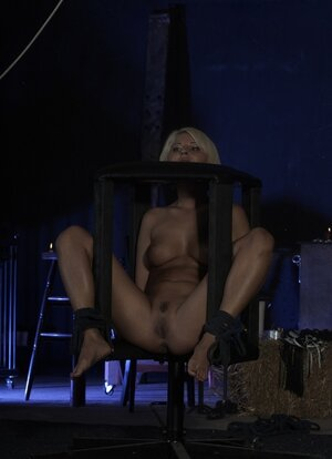 Blonde menial with tanned body blows fuck pole after master pulls ball gag out of mouth