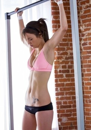 Fine workout motivates attractive chick to unleash perky tits from bra