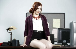 Nifty office girl satisfies viewers taking clothes off and posing with shoes on