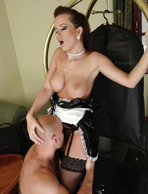 Housemaid in latex uniform and plus stockings gladdens bald boss with blowjob