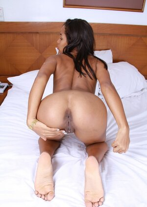 Sweet black sweetie has something pink between her legs to show off