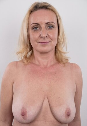 Dirty grown-up woman has saggy jugs and furthermore belly but still poses nude in studio