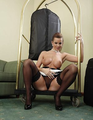 Sexy Cindy Dollar wears black vinyl suit and also gets rid of it exposing big tits